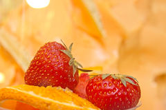 Closeup of strawberry fruit. With mellon background Stock Image