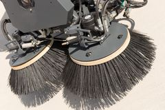 Closeup street sweeper machine. Cleaning the streets Stock Image