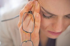 Closeup on stressed business woman. With eyeglasses Stock Photography