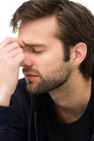 Closeup of a stressed handsome young man Stock Images