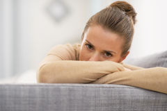 Closeup on stressed housewife in living room Stock Photography