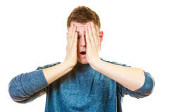 Closeup stressed man holds head with hands Stock Images