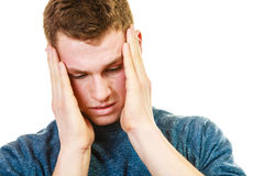 Closeup stressed man holds head with hands Royalty Free Stock Image