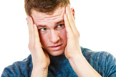 Closeup stressed man holds head with hands Stock Photo
