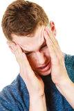 Closeup stressed man holds head with hands Stock Photos