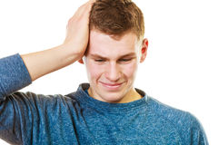 Closeup stressed man holds head with hands Stock Photography