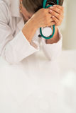 Closeup on stressed medical doctor woman Stock Photography