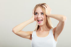 Closeup stressed woman covers ears with hands Royalty Free Stock Images