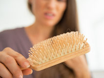 Closeup on stressed woman looking on hair comb Royalty Free Stock Image