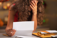 Closeup on stressed woman reading letter Stock Photo