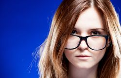 Closeup strict young woman with nerd glasses Royalty Free Stock Image