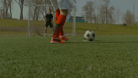 Soccer player taking a penalty kick during game stock video footage