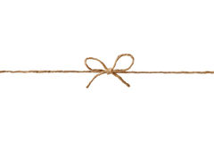 Closeup string or twine tied in a bow isolated on white Royalty Free Stock Photo