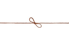 Closeup string or twine tied in a bow isolated on white Stock Photography
