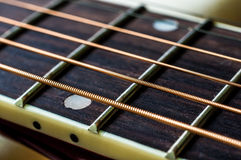 Closeup Of Strings And Fretboard Of Guitar Stock Photo