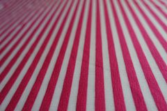Closeup of striped fabric in pink and white. Close view of striped fabric in pink and white Royalty Free Stock Photography