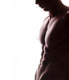 Closeup of strong athletic man on white background royalty free stock image