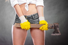 Closeup of strong woman feminist with axe working. Stock Images