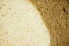 Closeup of structure of white and brown loaf stock image