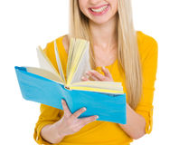 Closeup on student girl leaf through book Royalty Free Stock Photo