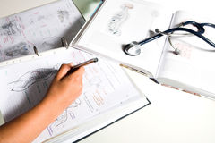 Closeup of a student learning medicine Royalty Free Stock Images