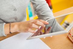 Closeup Of Student Using Digital Tablet In Library Stock Images