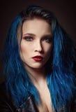 Closeup studio portrait of beautiful young woman with blue hair. Closeup studio portrait of a beautiful young woman with blue hair royalty free stock image