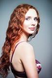 Closeup studio portrait of pretty redhead woman. Half-turned Stock Photos