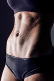Closeup studio shot fitness woman abs Royalty Free Stock Photography