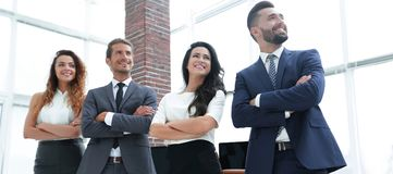 Successful business team looking at copy space Stock Photo
