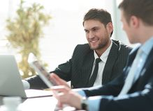 Closeup.successful businessman with a colleague discussing work issues Royalty Free Stock Images