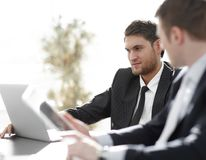 Closeup.successful businessman with a colleague discussing work issues Royalty Free Stock Image