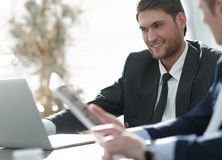 Closeup.successful businessman with a colleague discussing work issues Stock Photo