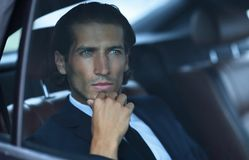Closeup.successful businessman sitting in the car Stock Photos