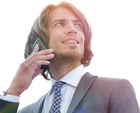 Closeup.successful businessman talking on the phone. Isolated on a white background Royalty Free Stock Image