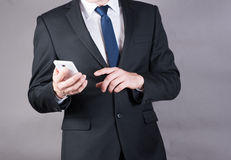 Closeup of a successful businessman using mobile smart phone Royalty Free Stock Photography