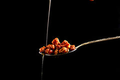Closeup of sugar peanuts on black background Stock Photography