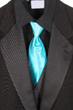 Closeup of suit and blue tie Royalty Free Stock Images