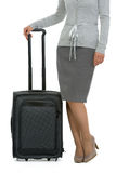 Closeup on suitcase near female legs Stock Photo