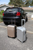 Closeup of suitcases by car ready to go on holidays Royalty Free Stock Image