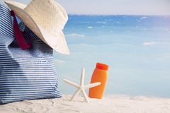 Closeup of summer beach bag on sandy beach Stock Photos