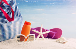 Closeup of summer beach bag on sandy beach Stock Images