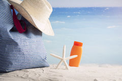 Closeup of summer beach bag on sandy beach Royalty Free Stock Photos