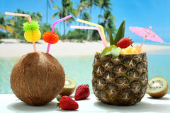 Summer cocktails coconut and pineapple on the beach Royalty Free Stock Photography