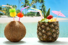 Fruit cocktails coconut and pineapple on the beach Royalty Free Stock Images