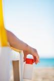 Closeup on sun block creme in female hand Stock Image