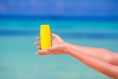 Closeup suncream bottle background blue sea Royalty Free Stock Images