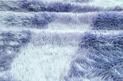 Closeup surface abstract fabric pattern at the blue fabric carpet at the floor of house texture background Royalty Free Stock Photo