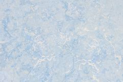 Closeup surface abstract marble pattern at the blue marble stone floor texture background. Closeup surface abstract marble pattern at blue marble stone floor royalty free stock photography