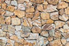 Closeup surface brick pattern at old stone brick wall textured background royalty free stock image